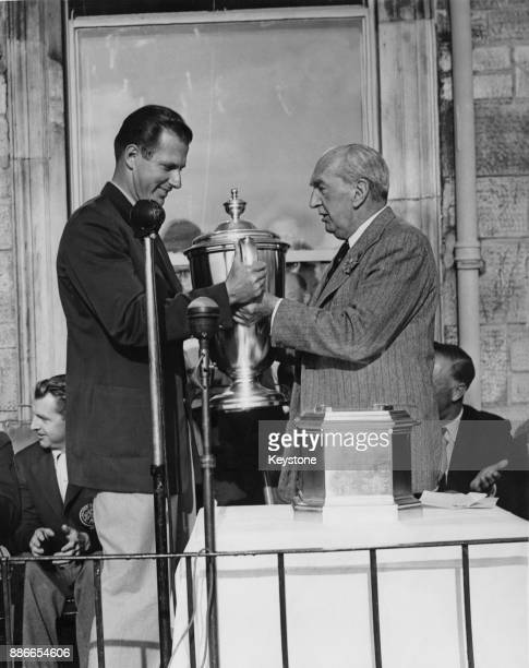 Lord Stanley Bruce , former Prime Minister of Australia, presents the Walker Cup to Bill Campbell , captain of the victorious American team, at St...