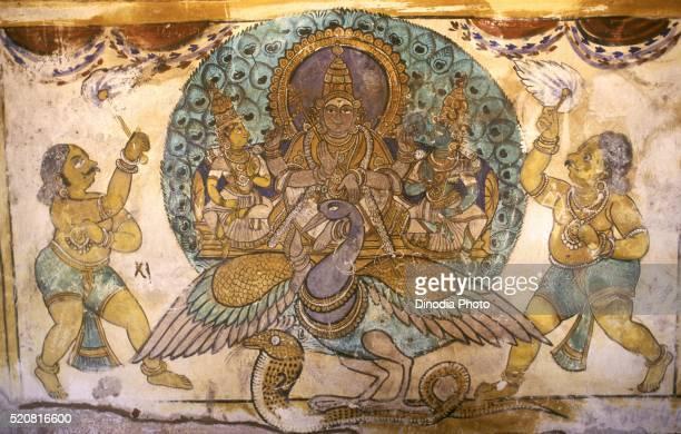 Lord subrahmanya with valli and devasena on peacock eighteenth century mural in Brihadeeshswara temple Thanjavur