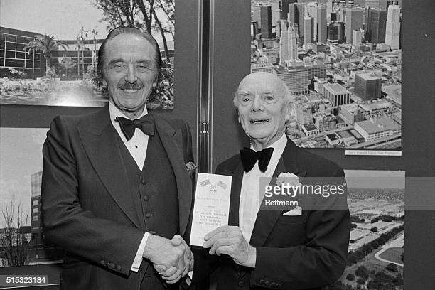 Lord Taylor Woodrow of Hadfield is congratulated by Fred Trump chairman of the Board of Trump Organization on his 50 years in America during...
