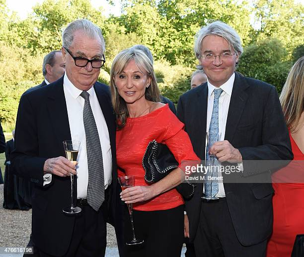 Lord Tim Bell Jackie Philips and The Rt Hon Andrew Mitchell MP attend the Bell Pottinger Summer Party at Lancaster House on June 10 2015 in London...