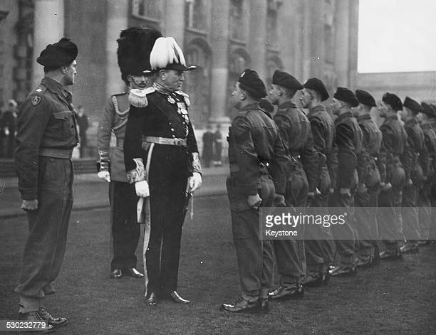 Lord Wakehurst new Governor of Northern Ireland inspecting the Guard of Honor of the Northern Irish Brigade on his arrival in Belfast with Sergeant...