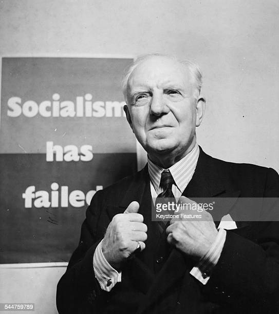 Lord Woolton, Chairman of the Conservative Party, posing in front of a 'Socialism Has Failed' poster, prior to the General Election, circa 1950.