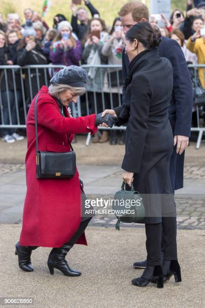 LordLieutenant of South Glamorgan Morfudd Meredith greets Britain's Prince Harry and his fiancée US actress Meghan Markle during a visit to Cardiff...