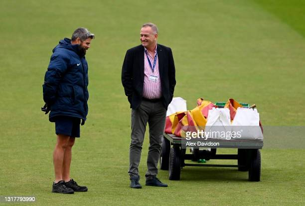 Lord's Head Groundsman Karl McDermott speaks to Middlesex CCC Chief of Staff , Andrew Cornish as play is delayed due to rain on Day One of the LV=...