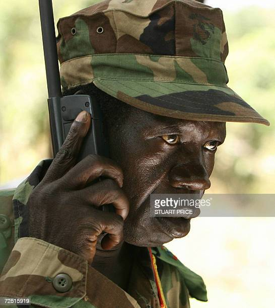 Lord's Resistance Army deputy commander Vincent Otti talks on a sattelite telephone 12 November 2006 before a meeting between the rebel group's...