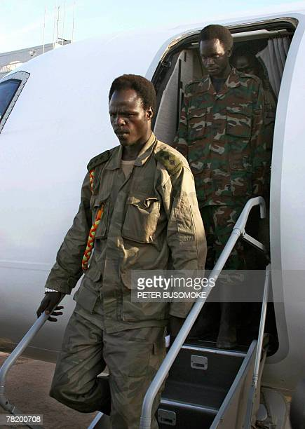 Lord's Resistance Army, LRA, Capt. Sunday Otto disembarks from a plane at Entebbe airport where he and six other LRA absconders were received by...