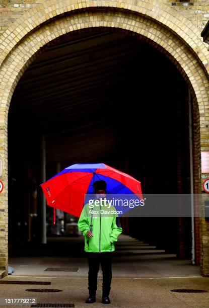Lord's steward waits in the rain as play is delayed on Day One of the LV= Insurance County Championship match between Middlesex and Hampshire at...