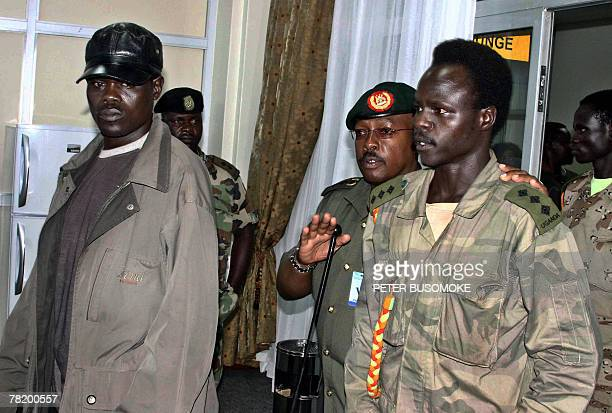 Lords's Resistance Army, LRA, captain, Sunday Otto [L] and Leutenant Richard Odong [4thL] are received in this 30 November 2007 photo, by Uganda...