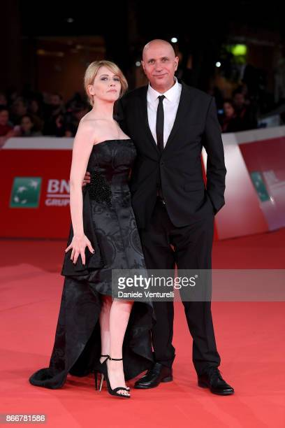Loredana Cannata and a Francesco Cinquemani walk a red carpet for Hostiles during the 12th Rome Film Fest at Auditorium Parco Della Musica on October...
