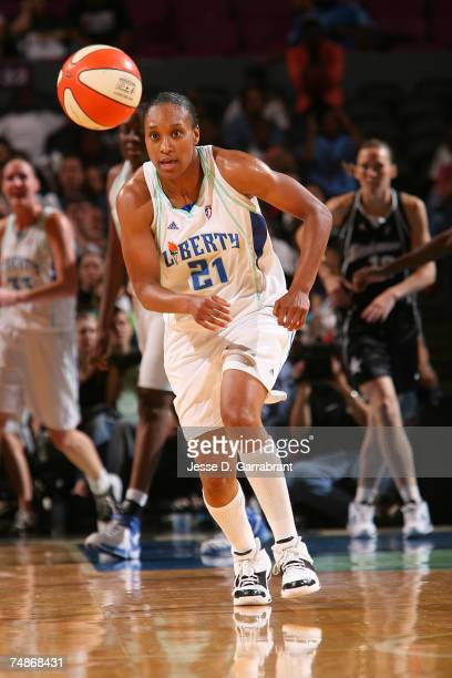 Loree Moore of the New York Liberty gains possession of the ball against the San Antonio Silver Stars at Madison Square Garden June 22 2007 in New...