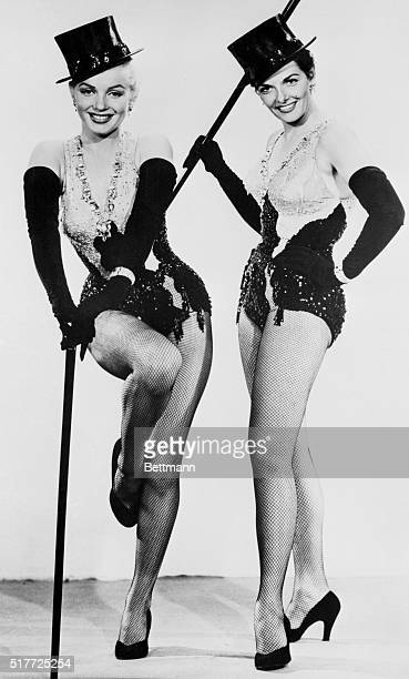 Lorelei Lee and Dorothy Shaw dance with top hats and canes in Gentlemen Prefer Blondes.