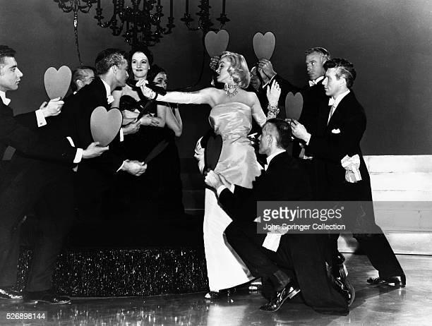 Lorelei Lee is surrounded by men offering her their hearts in Gentlemen Prefer Blondes.