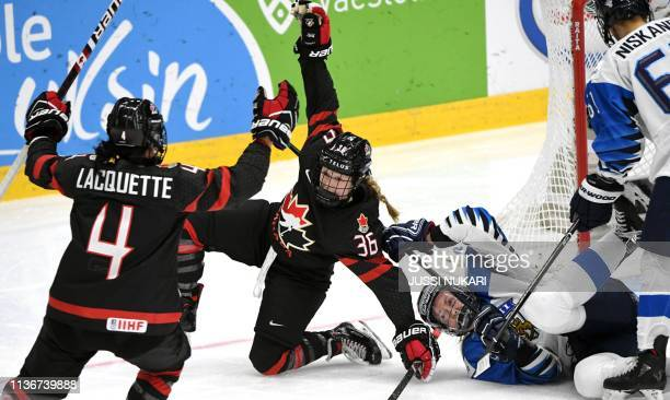 Loren Gabel of Canada celebrates her equalizing 22 goal with Brigette Lacquette while Rosa Lindstedt of Finland falls during the IIHF Women's Ice...