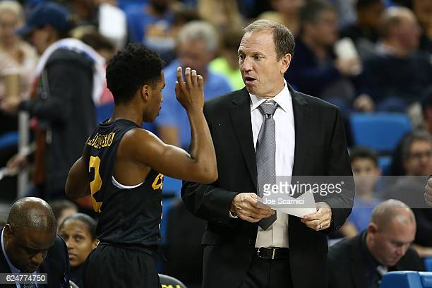 Loren Jackson of the Long Beach State 49ers and head coach Dan Monson of the Long Beach State 49ers talk on the side lines in the first period...