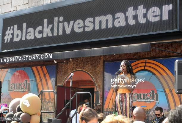 Loren Lott performs onstage at Comic and Hollywood Communities Coming Together to Mark Juneteenth Anniversary of Freedom on June 19 2020 in West...