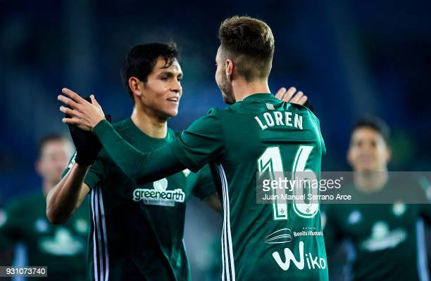 Loren Moron of Real Betis Balompie celebrates with his teammate Aissa Mandi of Real Betis Balompie after scoring the opening goal during the La Liga...