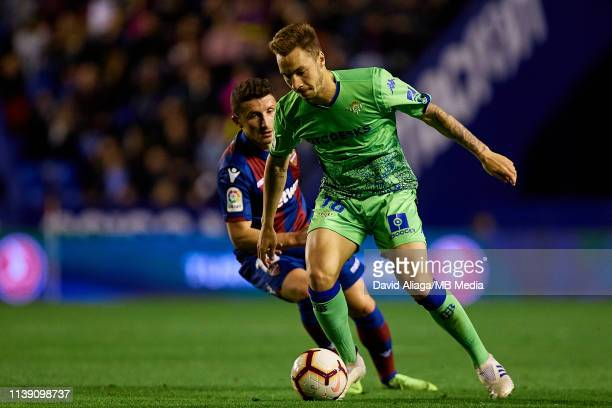 Loren Moron of Real Betis Balompie competes for the ball with Enis Bardhi of Levante UD during the La Liga match between Levante UD and Real Betis...