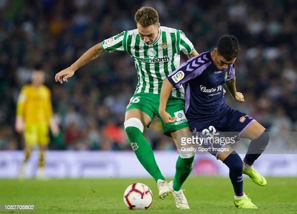 Loren of Betis competes for the ball with Leo Suarez of Valladolid during the La Liga match between Real Betis Balompie and Real Valladolid CF at...