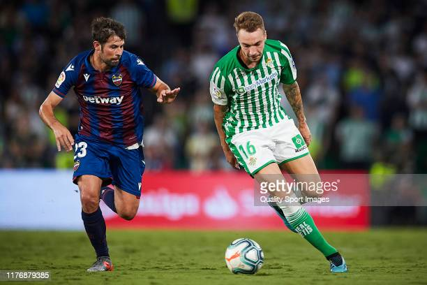 Loren of Real Betis competes for the ball with Coke Andujar of Levante UD during the Liga match between Real Betis Balompie and Levante UD at Estadio...
