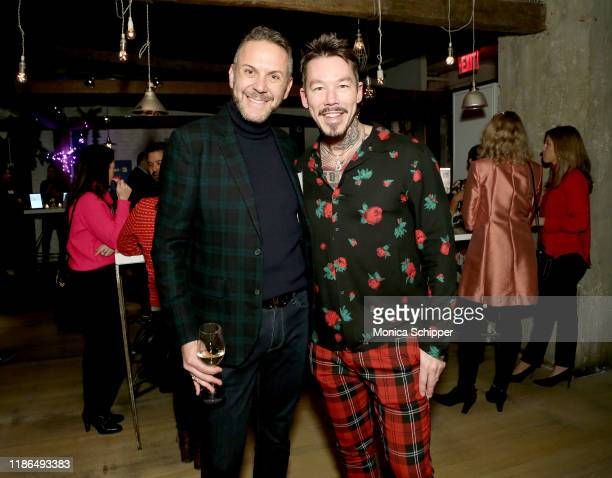 Loren Ruch and David Bromstad attend the Discovery Inc Holiday Press Party 2019 at ABC Kitchen on December 03 2019 in New York City