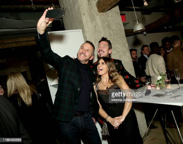 Loren Ruch and David Bromstad take a selfie during the Discovery Inc Holiday Press Party 2019 at ABC Kitchen on December 03 2019 in New York City