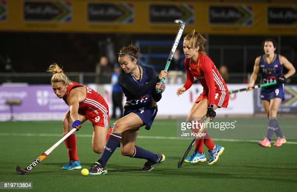 Loren Shealy of United States of America takes a shot at goal under pressure from Susannah Townsend of England during day 7 of the FIH Hockey World...