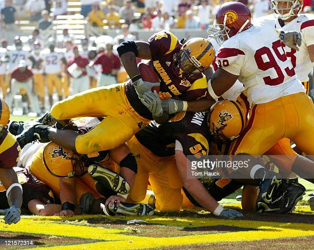 Loren Wade of the Arizona State Sun Devils dives for a touch down against the USC Trojans in the third quarter at Sundevil Stadium in TempeAZ USC won...