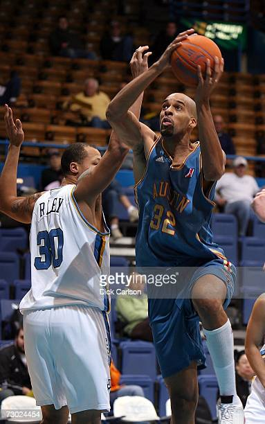 Loren Woods of the Austin Toros eyes the basket as he drives past Roderick Riley of the Bakersfield Jam during their game at the 2007 NBA DLeague...