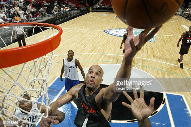 Loren Woods of the Charlotte Bobcats goes to the basket during the 2004 Minnesota Pro Summer League Game against the Detroit Pistons at the Target...