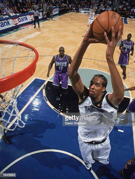 Loren Woods of the Minnesota Timberwolves goes to the basket during the NBA game against the Milwaukee Bucks at Target Center on November 7 2002 in...