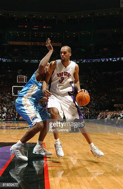 Loren Woods of the Toronto Raptors drives to the basket during the game against the Denver Nuggets at Air Canada Centre on December 10 2004 in...