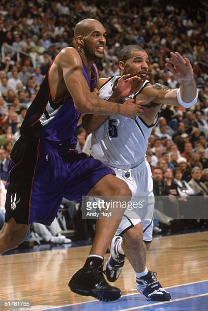 Loren Woods of the Toronto Raptors moves to the basket against Carlos Boozer of the Utah Jazz at Delta Center on November 10 2004 in Salt Lake City...