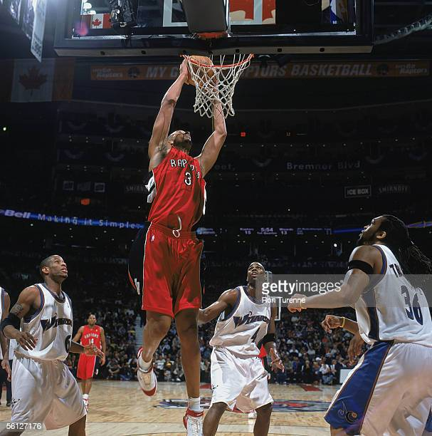 Loren Woods of the Toronto Raptors reaches for the basket against the Washington Wizards at Air Canada Centre on November 2 2005 in Toronto Ontario...