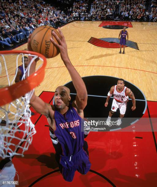 Loren Woods of the Toronto Raptors takes the ball to the basket during a game against the Portland Trail Blazers at The Rose Garden on November 13...