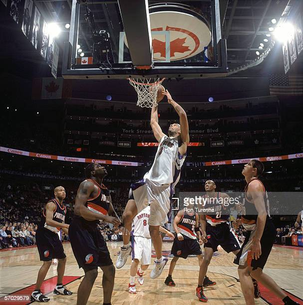 Loren Woods of the Toronto Raptors takes the ball to the basket during the game against the Portland Trail Blazers at Air Canada Centre on February...