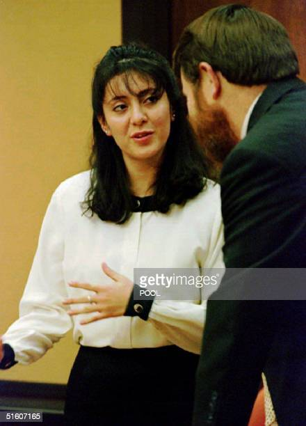 Lorena Bobbitt confers with her attorney James Lowe after the jury asked two questions as they deliberated in her malicious wounding trial at the...
