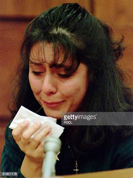 Lorena Bobbitt cries as she testifies about the night she cut her husband John Wayne Bobbitt's penis off 14 January 1994 on the fourth day of her...