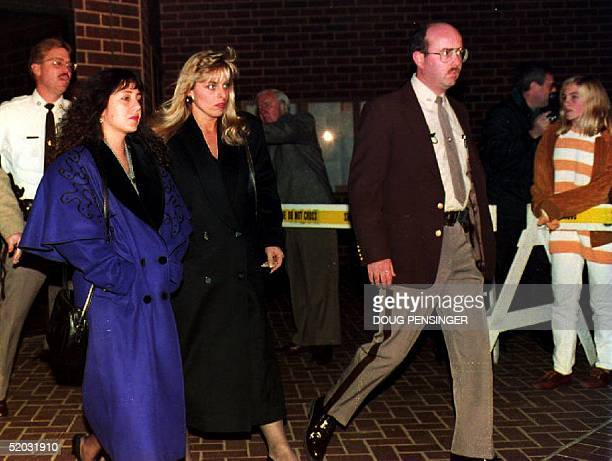 Lorena Bobbitt leaves the courthouse with an unidentified woman 08 November 1993 where her husband John Wayne Bobbitt is on trial for marital sexual...
