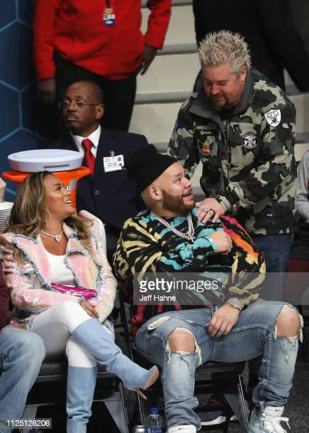 Lorena Cartagena and Fat Joe greet Guy Fieri during the 2019 NBA AllStar Celebrity Game at Bojangles Coliseum on February 16 2019 in Charlotte North...