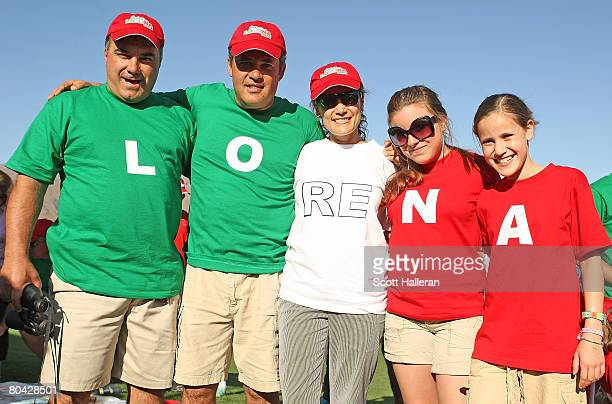 Lorena Ochoa fans pose on the 18th hole during the third round of the Safeway International at Superstition Mountain Golf and Country Club on March...