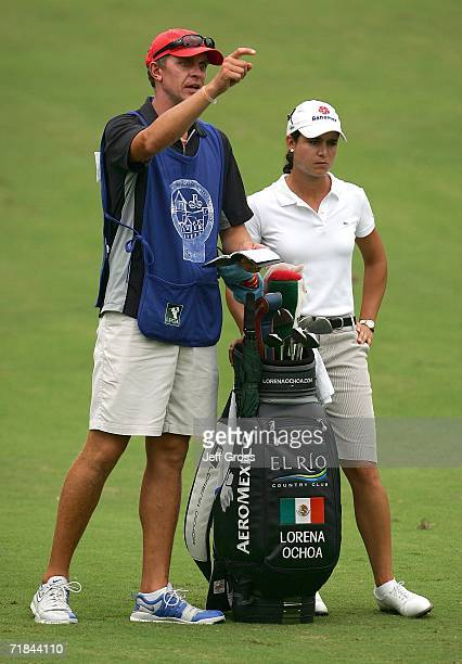 Lorena Ochoa of Mexico and her caddie David Brooker discuss a shot on the tenth hole during the final round of the John Q Hammons Hotel Classic on...