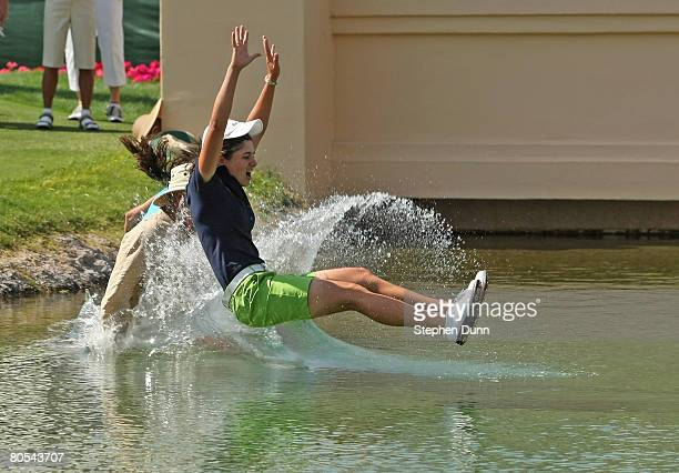 Lorena Ochoa of Mexico jumps into the water to celebrate her victory after the final round of the Kraft Nabisco Championship at Mission Hills Country...