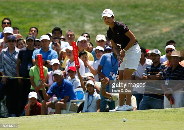 Lorena Ochoa of Mexico putts for a eagle on the eighth green during the second round of the Corona Championship at Tres Marias Club de Golf April 11...