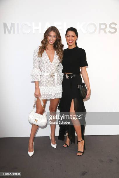 Lorena Rae and Rebecca Mir attend the opening of the Michael Kors store on April 2 2019 in Munich Germany