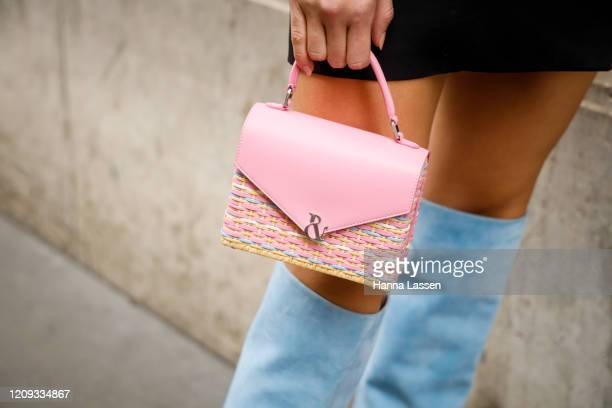 Lorena Rae bag detail wearing Ralph Russo blazer pink mini bag and baby blue knee high boots outside the Ralph Russo show during the Paris Fashion...