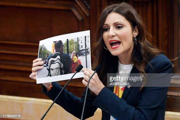 Lorena Roldan leader of the unionist group Ciudadanos in Catalonia shows a photograph to the chamber during a plenary session at the Catalan...