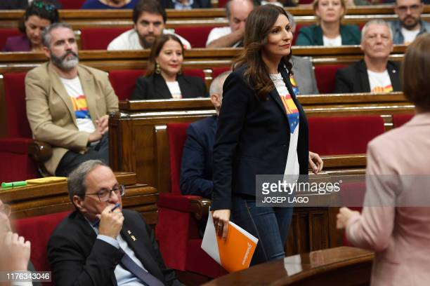 Lorena Roldan leader of the unionist group Ciudadanos in Catalonia walks past Catalan regional president Quim Torra as she goes to the lectern to...