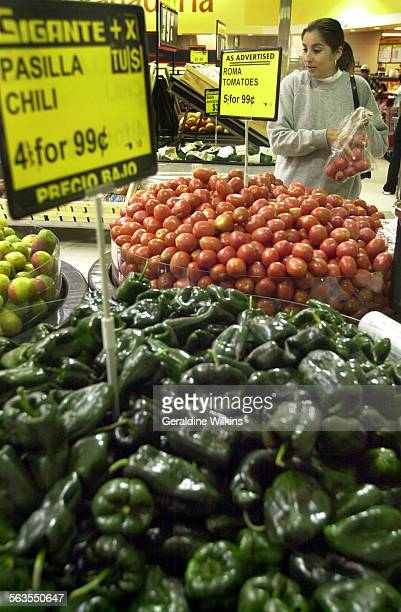 Lorena Salcedo of Anaheim buys Roma tomatoes at 99 cents for 5 pounds at Gigante supermarket Gigante Supermarket the third largest retailer in Mexico...