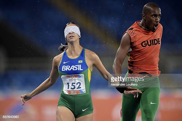 Lorena Salvatini and Ben Hur Costa competes the Women's 100m T11 Final during the Paralympics Athletics Grand Prix Aquece Rio Test Event for the Rio...