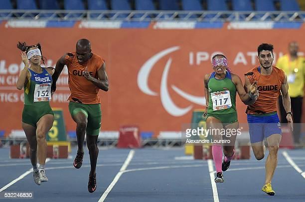 Lorena Salvatini Spoladore Renato Oliveira Terezinha Guilhermina and Rafael Lazarini competes the Women's 100m T11 Round 1 during the Paralympics...